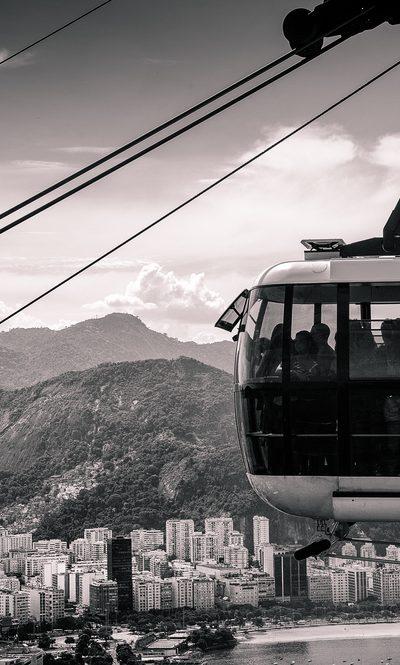 Overhead cable car moving over a city, Rio De Janeiro, Brazil